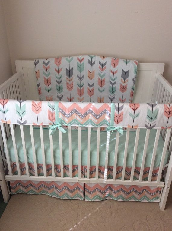 You will receive...... -1 Blanket (all arrows) -1 Fitted sheet, mint -1 Bumper in arrows and chevron centers with mint piping and ties -1 Bobby cover in arrow and mint minky -1 Diaper stacker in chevron and mint -1 Chevron skirt Please allow up to 8 weeks for completion. Thank you for supporting ***MADE IN THE USA***