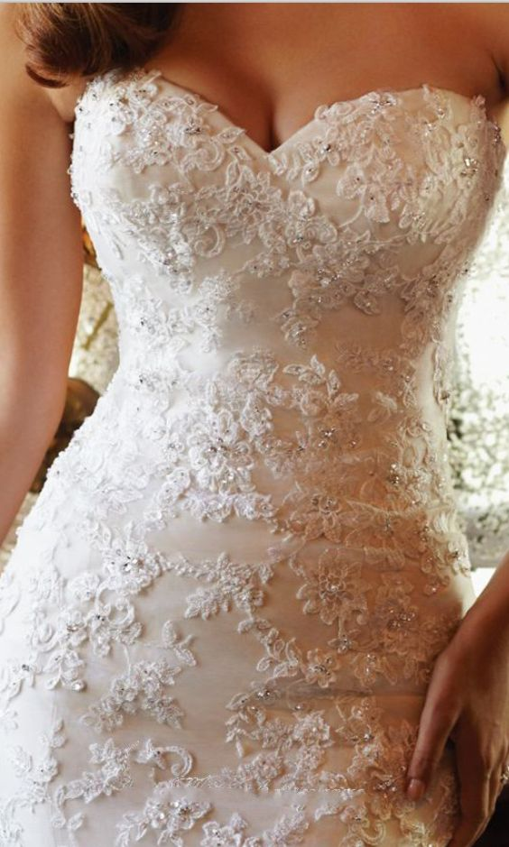Gorgeous lace wedding dress with a sweetheart neckline. The details!