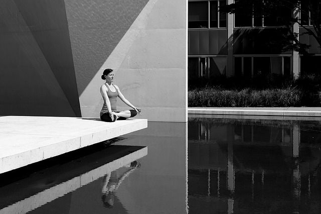 Black and white reflections of a yoga lotus pose #yoga #blackandwhite #reflection #yogapose