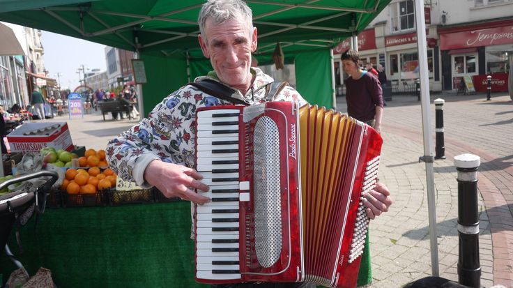 This jolly portrait of an accordion player is by blind photographer Ray