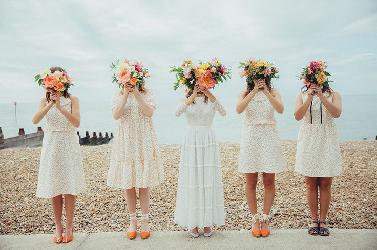 Bridesmaids in Orla Kiely Dresses | Coastal Wedding at East Quay Venue in Whitstable | Elizabeth Avey Bridal Gown | Bright Orange Florals by Palais Flowers | Doughnut Tower Wedding Cake | Deborah Grace Photography
