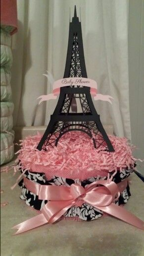 Paris baby shower diaper centerpiece. Made with silhouette Cameo Eiffel Tower and banner. Damask fabric, pink recollections burlap and satin ribbon.