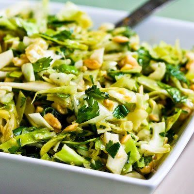 Spicy Cilantro-Peanut Cabbage Slaw has Sriracha in the dressing. [from KalynsKitchen.com] #DeliciouslyHealthyLowCarb