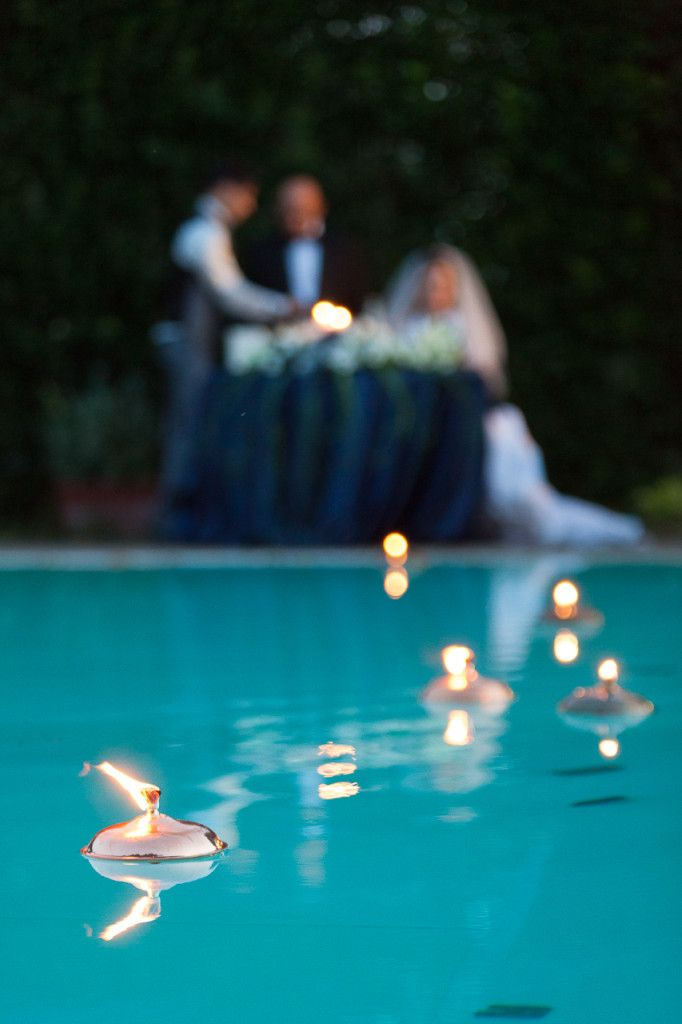 17 best images about poolside wedding on pinterest floating candles pool candles and backyard for Floating candles swimming pool wedding