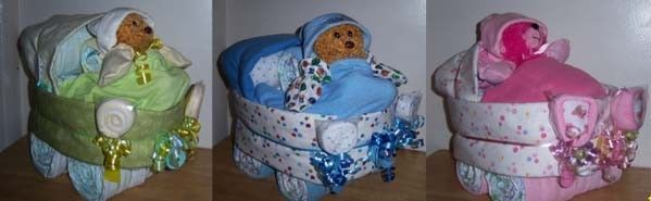 This is handmade with about 65+ Diapers, 3 Receiving Blankets, Pacifier, Hat, Gloves, about 16 Wash Cloths, Burp Cloth, Bear, 2 Lollipops made with baby fork, baby spoon, and 4 wash cloths!