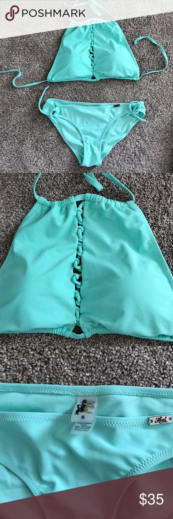 Mint bikini Only worn once and not in the water! Like new!   brand: Heat  Bottoms: adjustable tie side -size small  Top: string adjustable- size large, fits like a medium in my opinion. I'm a size 32 D or 34c. Padding included Billabong Swim Bikinis