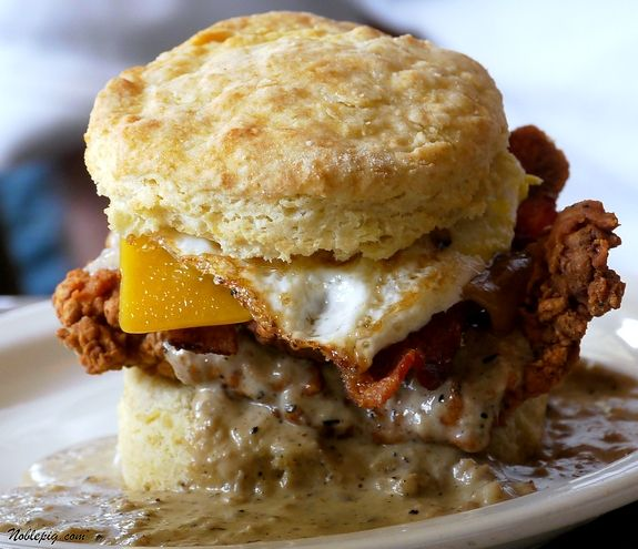OMG.  There are no words for this.  Fried chicken, bacon and cheese topped with sausage gravy and a fried egg