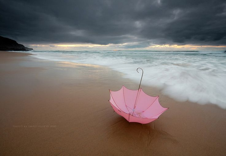 Pink Umbrella On The Beach.