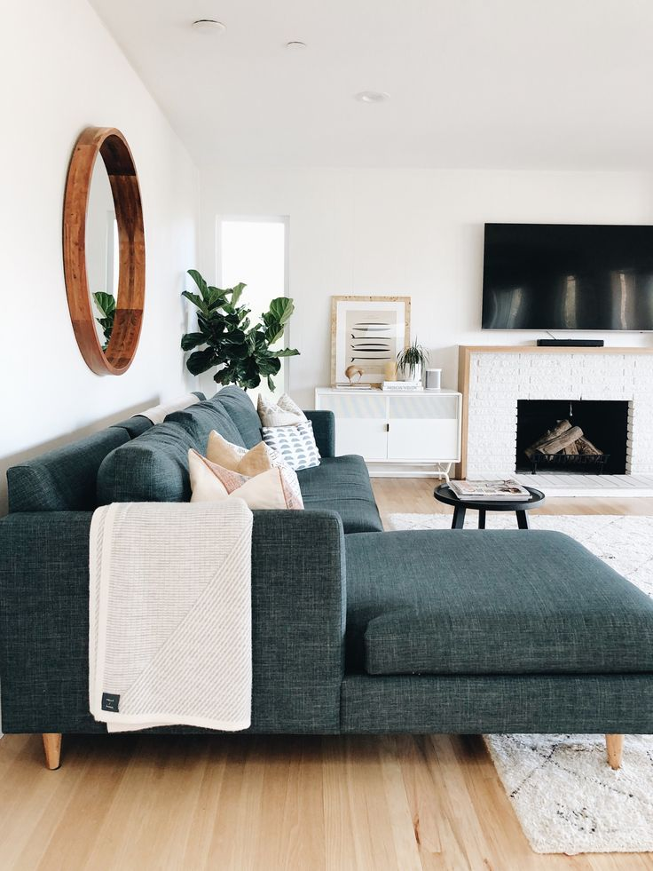 Dark blue tweed couch looks sophisticated and adds…