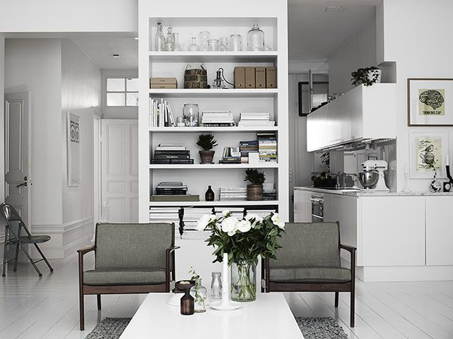 Homes: Monochrome  This discreet kitchen hides away in deference to the living area. Its unobtrusiveness comes in part from the all-white scheme (to achieve this look cheaply, Ikea is your friend), white floor boards (to make a tight space look bigger) and pale grey worktop (probably marble).