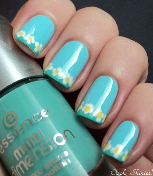 Light blue nails with little white flowers with yellow centers - nail art design