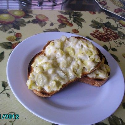 """Artichoke Bread I """"My brunch guests LOVED this recipe. I made the artichoke spread the night before, so the morning of my company I just had to spread it and bake it. It's incredibly delicious, versatile, and next time I'm going to make a double recipe!"""""""