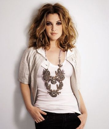 Drew Barrymore - hairstyle for thin hair - curled and wild - she used  mix of curlers and styling gel to make her hair look big and beautiful.