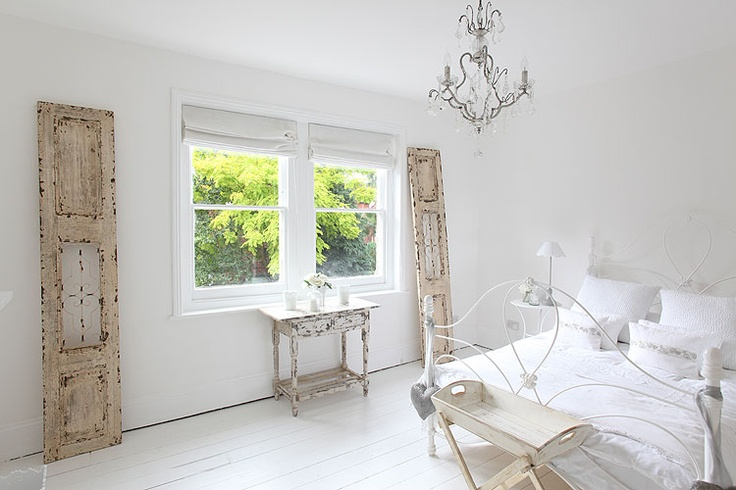Shutters complete a serene bedroom.