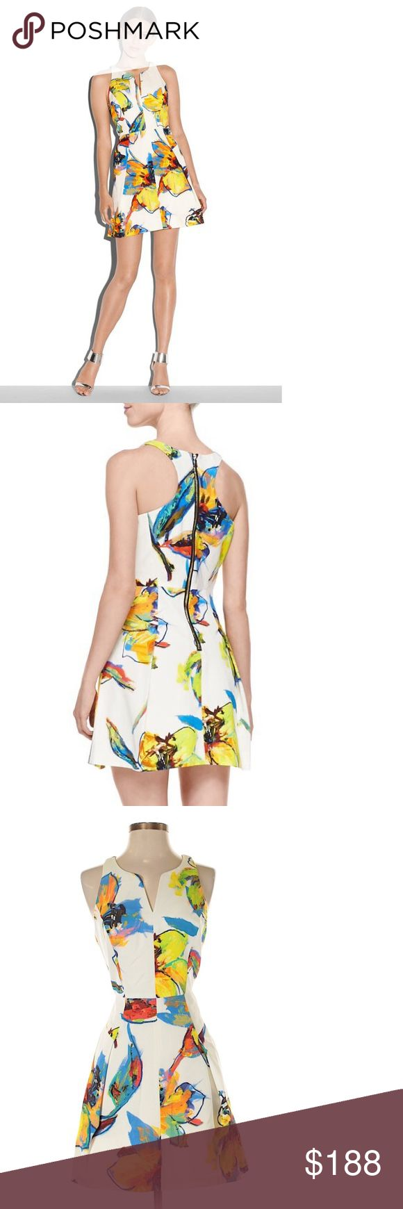 """NWT. Milly Floral Print Dress New with Tag. Excellent Condition. Never worn.  Waist 27"""". Armpit to armpit 17.5"""". Length 34.5"""".  Racerback Dress. Fashioned in Italian Pop Art Floral Print on Faille. Sleeveless racerback dress with flare skirt and side pockets. 58% cotton, 42% viscose.  Have some fun with this playful pop art floral print racerback dress! Pops of yellow and blue add just the right amount of color to your look. #4128 Milly Dresses"""