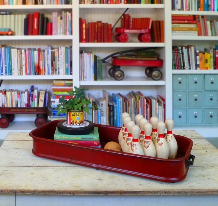 Recycle a crusty, two-wheel, broken-down vintage red wagon into a neat display tray (notice the wheel used as a saucer under the plant in a Peanut can!)