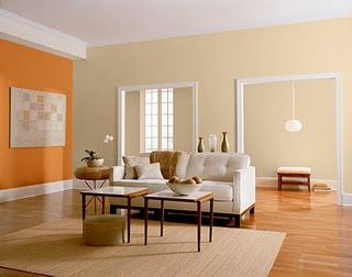 i love the white trim the wood floors and the orange accent wall