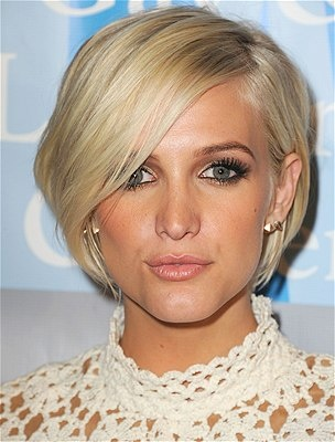 I likey!!! Wonder if I could chop my hair and not go crazy! If I'm ever going short this is what I want.
