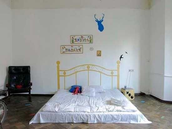 mattress on floor and bed headboard wall sticker