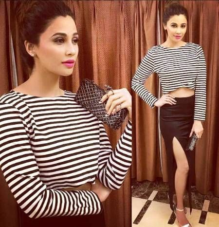 Daisy Shah's Monochrome Stripes Are So Cool... #DaisyShah recently flaunted her svelte figure in a long skirt with a thigh high slit and a crop top with horizontal stripes. She wore pink lipstick to contrast the look and tied her hair in a casual messy bun. We love how she's teamed with the right shoes too!.. Buy the look at https://www.estrolo.com/whatstrending/daisy-shahs-monochrome-stripes-are-so-cool/
