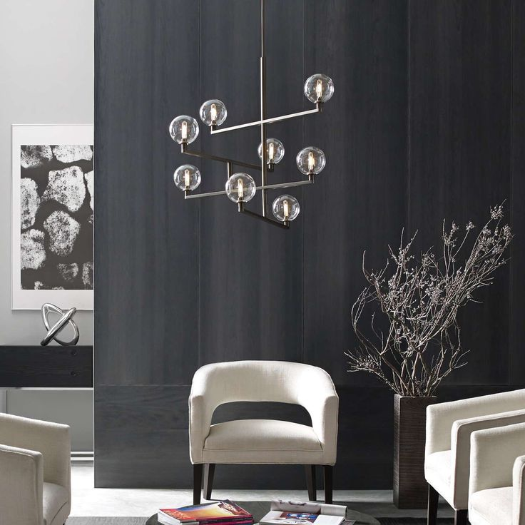 The Gambit LED chandelier exudes undeniable beauty and warm contemporary style through its bold use of high end mixed materials and retro-inspired, fully dimmable LED lamping.