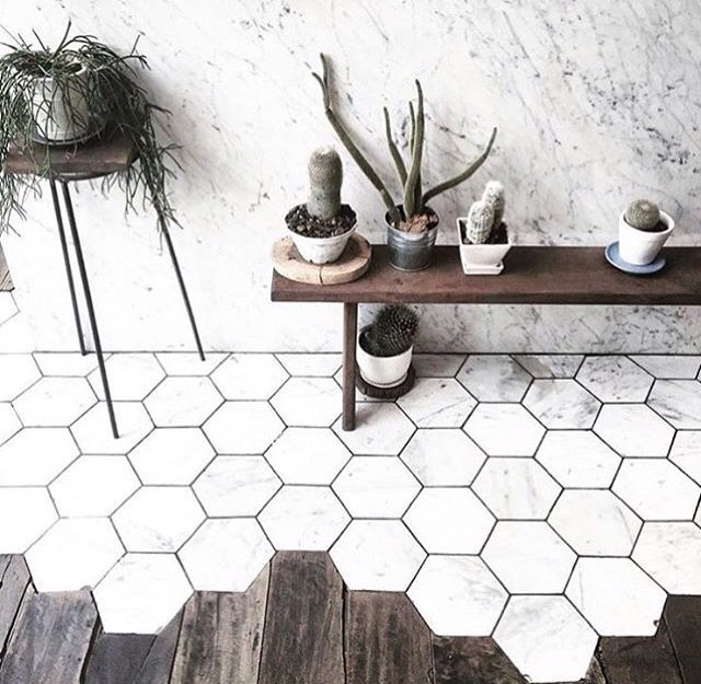 Obsessed with this flooring contemporary design marble roles and wooden floorboards.