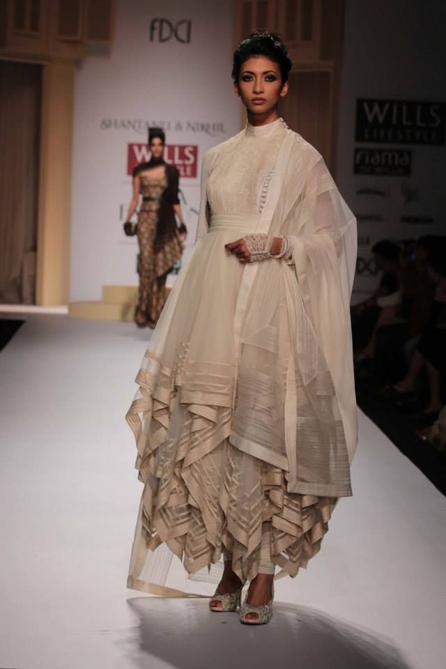 Peplums, stylish layers and elegant drapes took over the runway