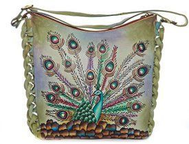 Magnifique peacock leather hand painted shoulder bag    Trendy, Cute and Luxurious Hand Painted Leather Purses      Hand painted leather purses are truly eye-catching, unique and cool.  In fact they are currently trending like crazy!  Obviously when you combine beautiful hand painted art, on fine quality leather the result is a timeless and charming creation just for you.