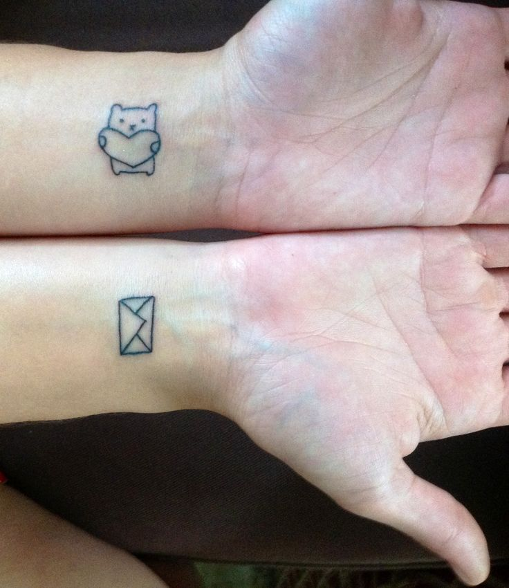 My spontaneous little wrist tattoos. Little envelope and little heart hugging bear from Michele's baby shower thank-yous. Work by Bob, Federal Hill Tattoo, Providence RI.
