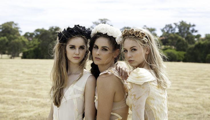 A High quality luxury faux silk flower crown headband fit for a queen. Our bridal crown collection is perfect to wear on your wedding day and we make smaller crowns for the bridesmaids to match. Choose from Royal Gold, Crisp white, Ruby Red and Luxe Black.  Made To Order By Grande Fiore Florist