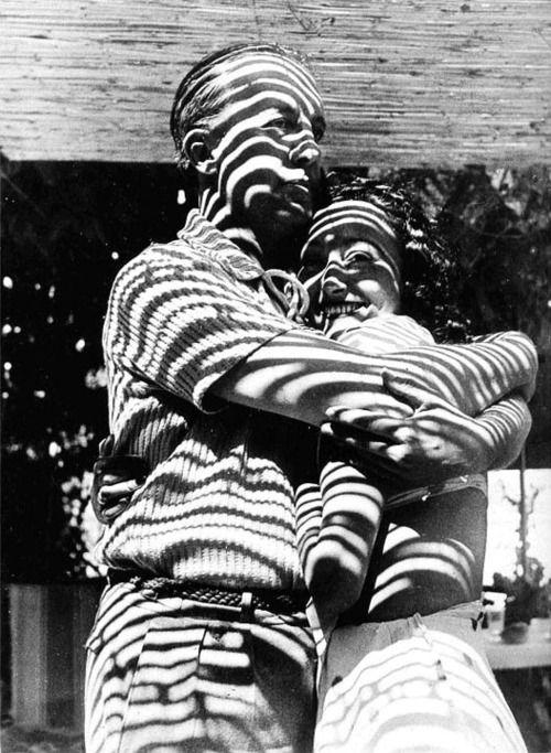 Paul and Nusch Éluard, Mougins 1937 -by Dora Maar [orig. caption: Paul et Nusch Éluardenlacés dans léblouissement du soleil, Hôtel Vastes Horizons