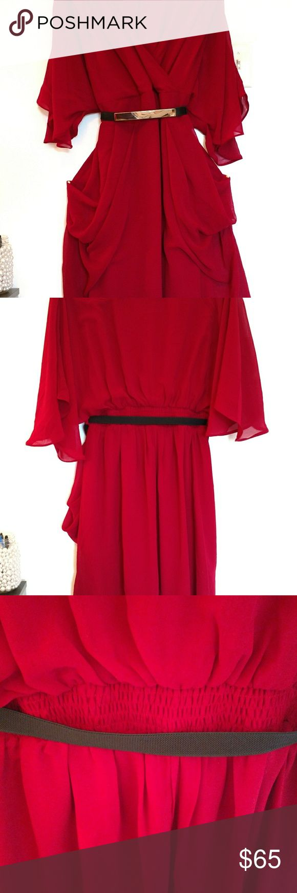 City Chic Red Dress The color is a deep cranberry with gold plate detail on the belt. This dress looks great on someone with curvy hips! Very sexy for date night, but not revealing. Ordered brand new from Nordstrom's. The dress comes to knee length and bust is covered. Also, it's fully lined so no panty lines visible. City Chic Dresses Midi