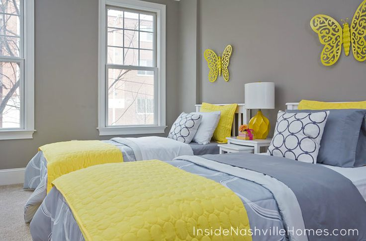The yellow is fabulous against these light grey walls and for Grey and yellow bedroom