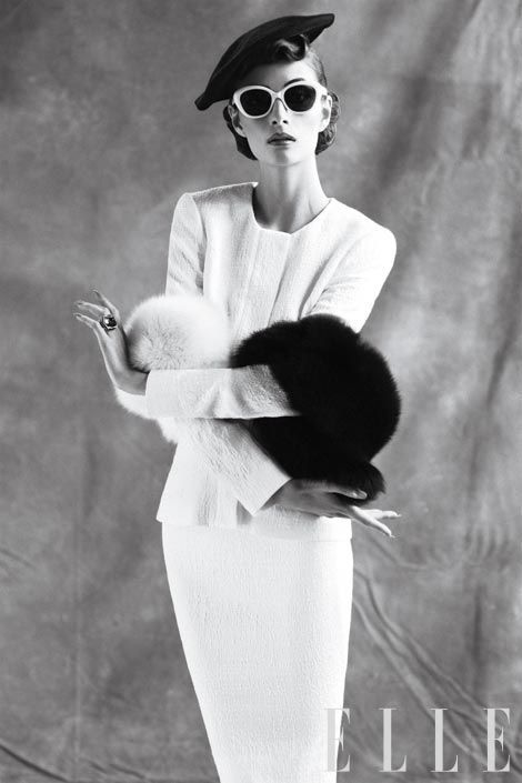 Cotton-and-silk jacket, skirt Oscar de la Renta; Felt beret, Heather Huey; Sunglasses, Marc Jacobs; Fox boa, Pologeorgis; Amethyst, diamond, and onyx ring, Cartier.
