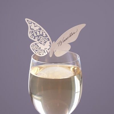 Exclusively Weddings | Butterfly Place Cards ... interesting idea. Different.