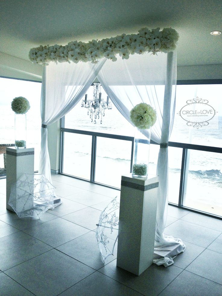 A beautiful wedding ceremony overlooking the beach at The Surf Club Mooloolaba. Styling by @Circle of Love Weddings