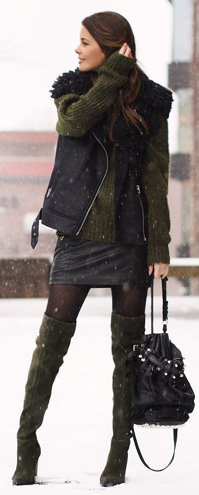 Make a black shearling vest and a black leather mini skirt your outfit choice for an effortless kind of elegance. For footwear go down the classic route with olive green suede over the knee boots.   Shop this look on Lookastic: https://lookastic.com/women/looks/shearling-vest-oversized-sweater-mini-skirt-over-the-knee-boots-bucket-bag/8803   — Olive Suede Over The Knee Boots  — Black Leather Bucket Bag  — Black Leather Mini Skirt  — Black Shearling Vest  — Olive Oversized Sweater