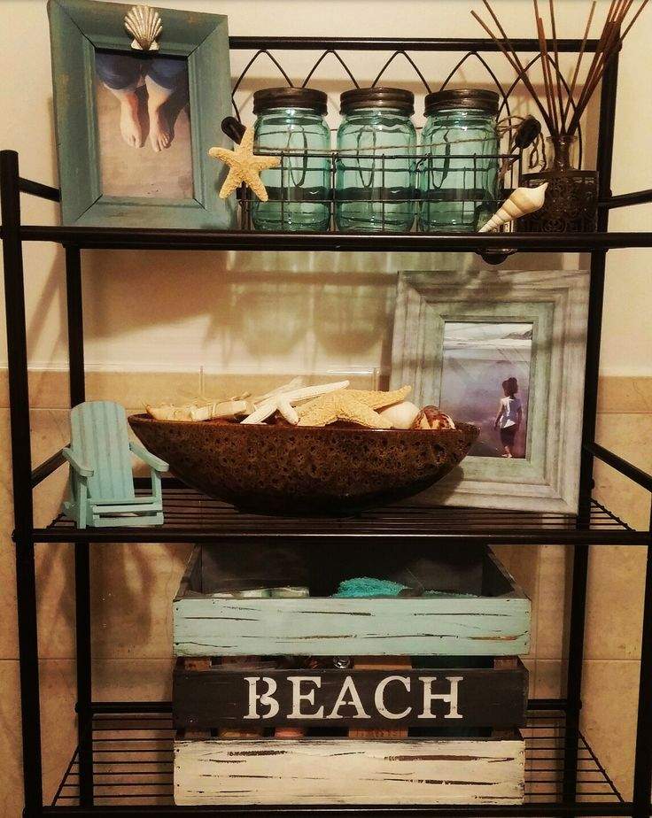 This is the start of my beach theme bathroom, it will change from time to time but so far I'm please with the color.  for a personal touch I added pictures of me and my family at the beach. :)