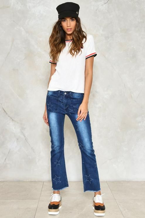 Seen a shooting star tonight and I thought of you. The Shooting Star Jeans come in medium wash denim and feature a 5-pocket design, raw hem, flare silhouette, zip fly closure, fading at legs, and stitched star detailing throughout.