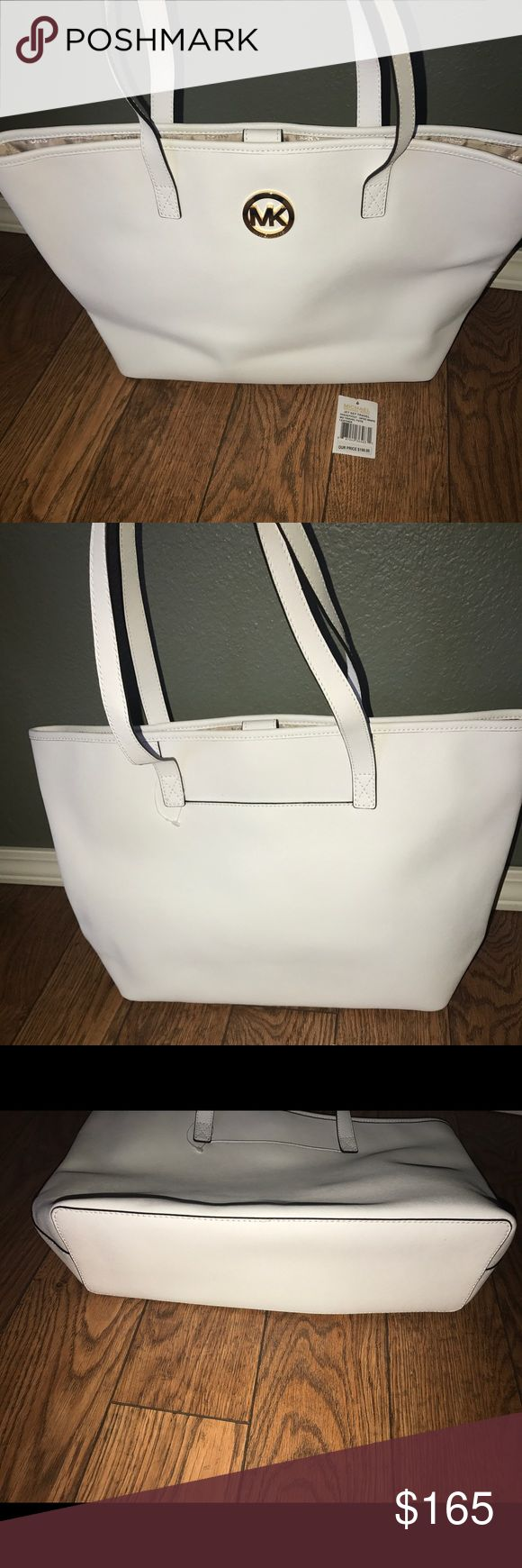 Michael Kors Jet Set Tote Authentic Michael Kors Jet Set Travel Tote! Great bag with lots of room, brand new never carried, tag fell off of the plastic loop. No rips, stains, tears or marks, comes from a smoke free home. In perfect condition! No trades please, offers welcome Michael Kors Bags Totes