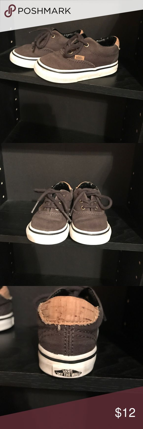 Vans toddler shoes Used in good condition Vans for toddler. They are gray with tan on the back of the heel and in the front lip where you tie the shoes. Still have a lot of life in them. You can see that they were worn on the sides as seen in last picture but that can be cleaned with shoe cleaner. Vans Shoes Sneakers