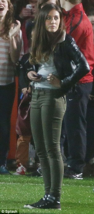 Taking to the pitch: Styles and Louis' girlfriend Eleanor walked the field as Louis went back into the locker