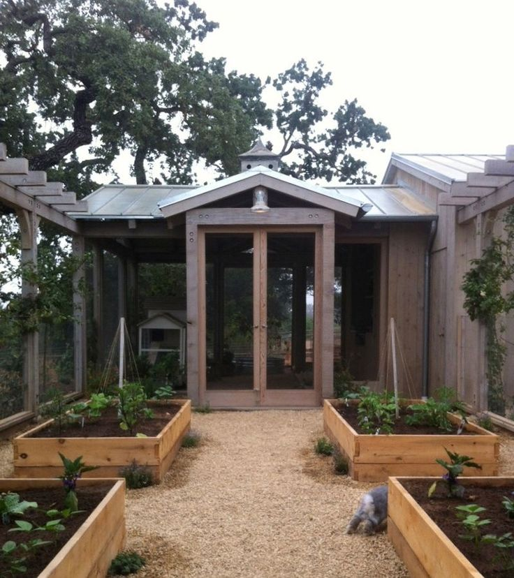"Another view of a pergola style (but not running all the way across) kitchen garden fence. I'd love to someday build a studio/storage building on the north side of our kitchen garden, so it makes the north end ""wall"" of the garden similar to this."