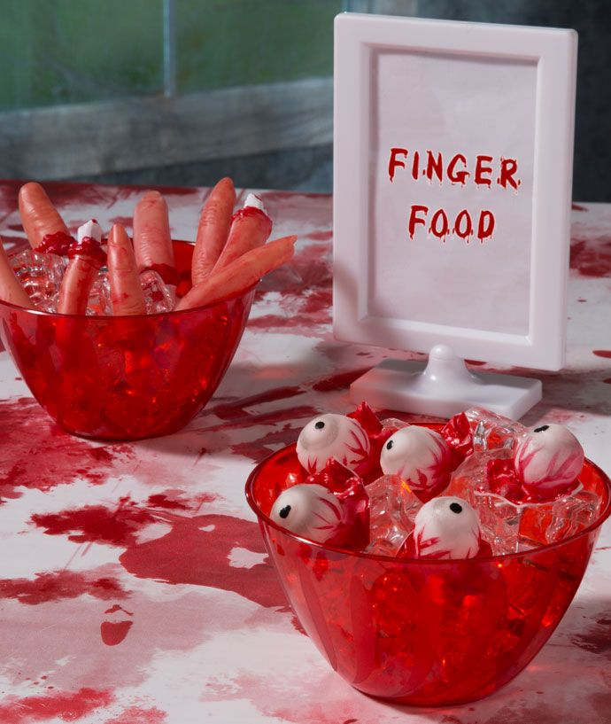 Find loads of gruesome zombie party food ideas on our blog - including this disgusting zombie finger food! Perfect for a zombie party at Halloween.