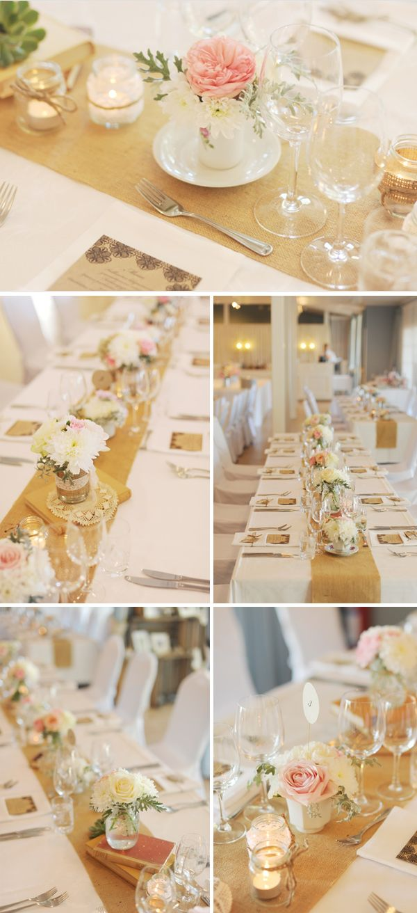 tables were lined with burlap table runners topped with vintage books, votive jars + loads of floral arrangements in jars and vintage tea and coffee cup.    THIS IS ALMOST EXACTLY WHAT I ENVISION!!