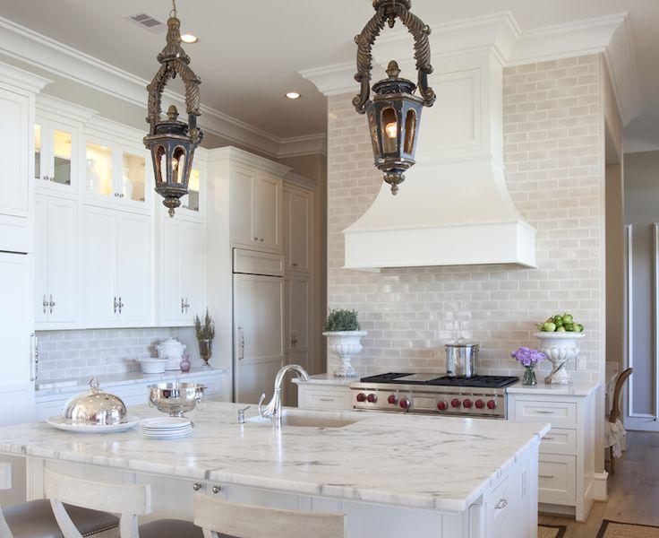kitchen with antique lanterns pendants, creamy white kitchen cabinets