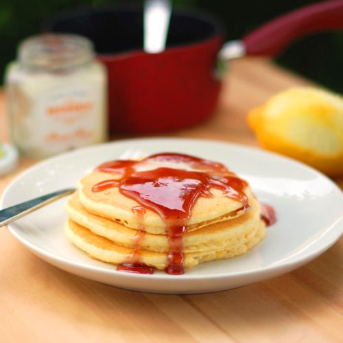 Amazing Lemon Pancakes that are light, fluffy, and easy to make topped with a blackberry syrup made from blackberry jam.