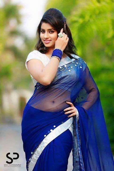 indian filmy actress: Beautiful Desi Diva latest Blue Transparent Saree photos with backless blouse