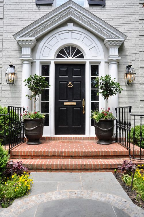 topiaries, black door... welcoming traditional entry