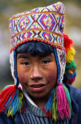 Young Peruvian wearing a traditional Shaman hat with intricate bead work & weaving patterns.  Photo by Sergio Pessolano, via Flickr